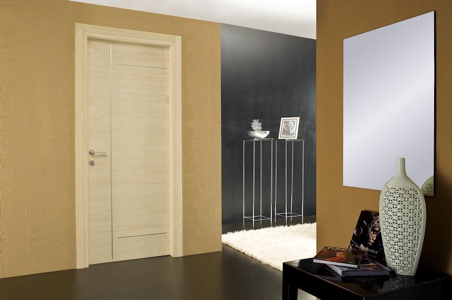 Оформлення приміщень з темною підлогою і світлими дверима